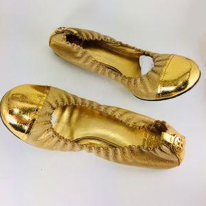 Tory Burch metallic gold size 10.5